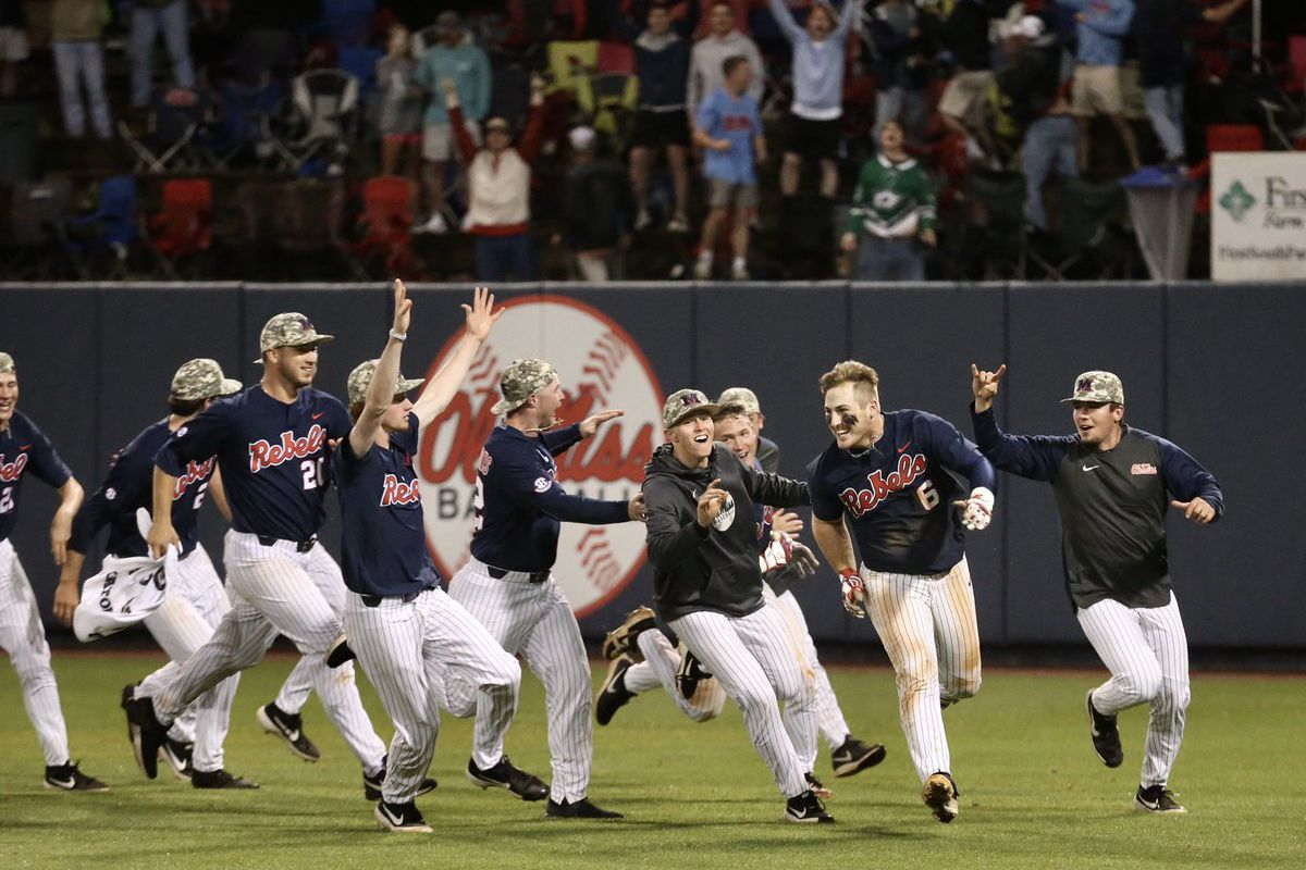 Ole Miss players celebrate a win in walk off fashion over Mississippi State.