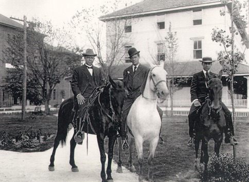 Booker T. Washington and sons on horseback