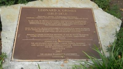 Marker at the location of the home Leonard A. Grimes shared with his wife and children.