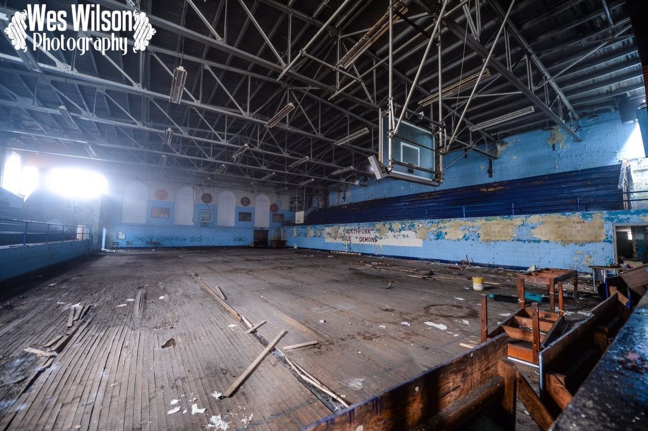 This image shows the historic gymnasium of the Northfork High School Blue Demons after the destruction of the floods.
