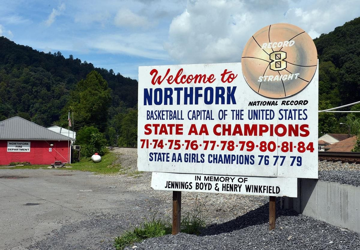 """A sign that still stands in the town of Northfork acknowledging it as the """"basketball capital of the United States."""""""