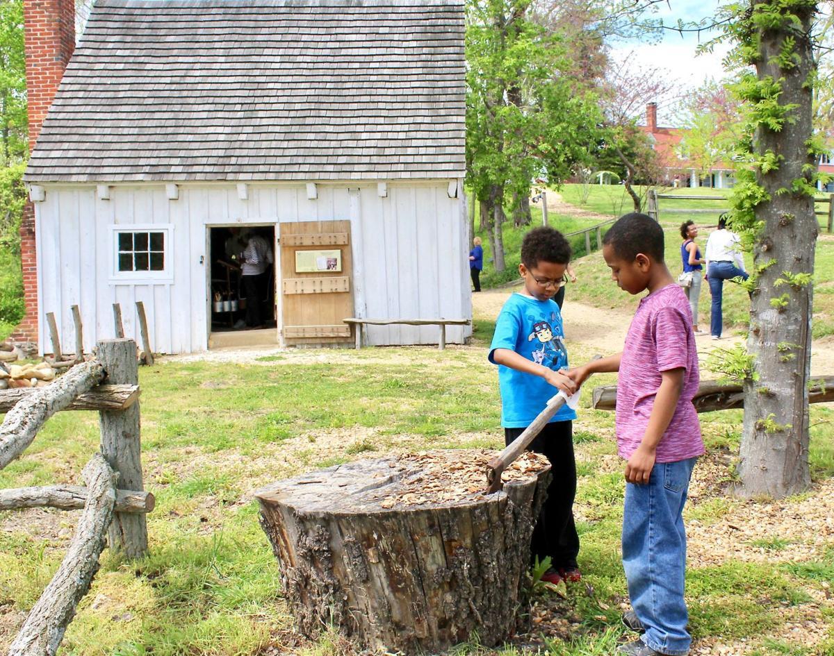 Families explore Sotterley's c.1830 slave cabin.
