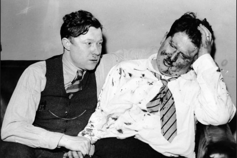 Walter Reuther and Richard Frankensteen after Ford Security guards beat them up for handing out leaflets in regard to the GM Strike in 1937.