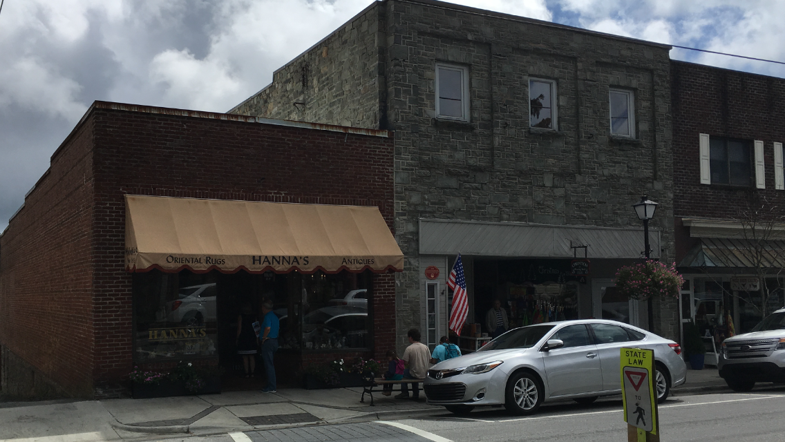 The original Hanna's building is the brick building with the awning on the left. The stone building on the right is the Yonahlossee Theater building. Photo 2018
