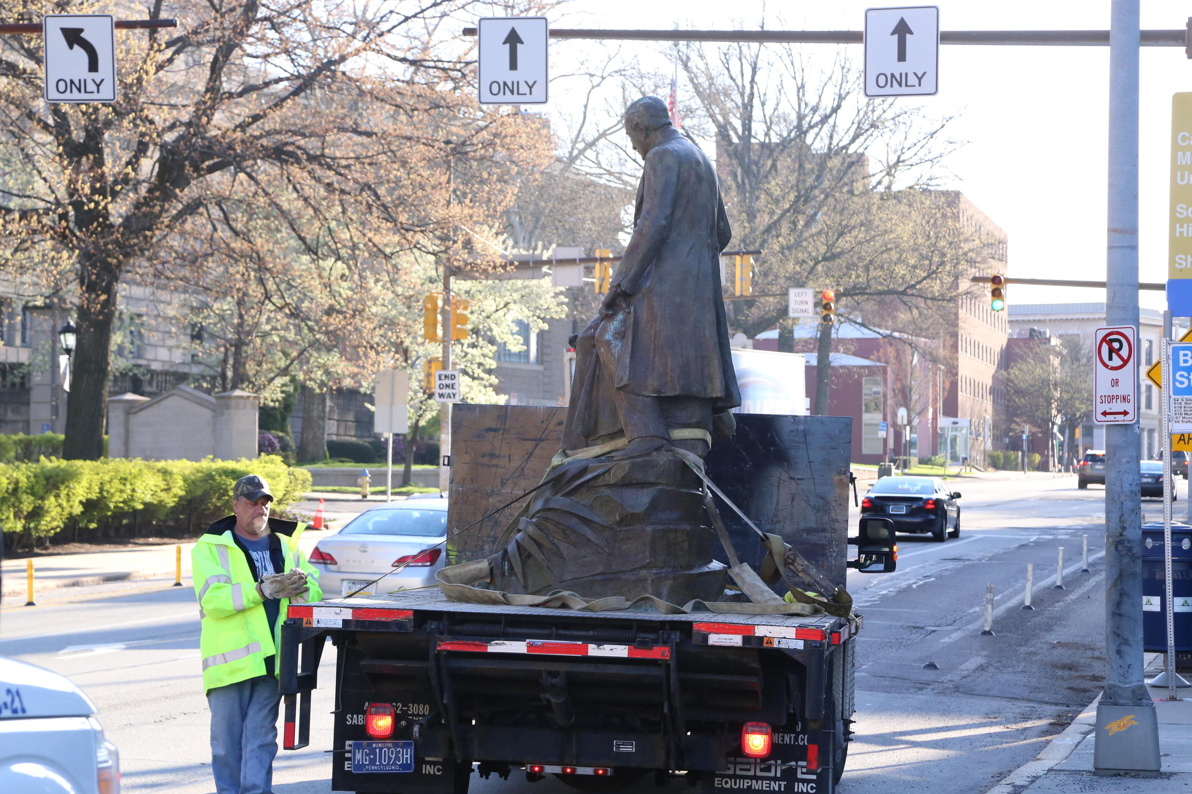 Statue being driven away from the original site