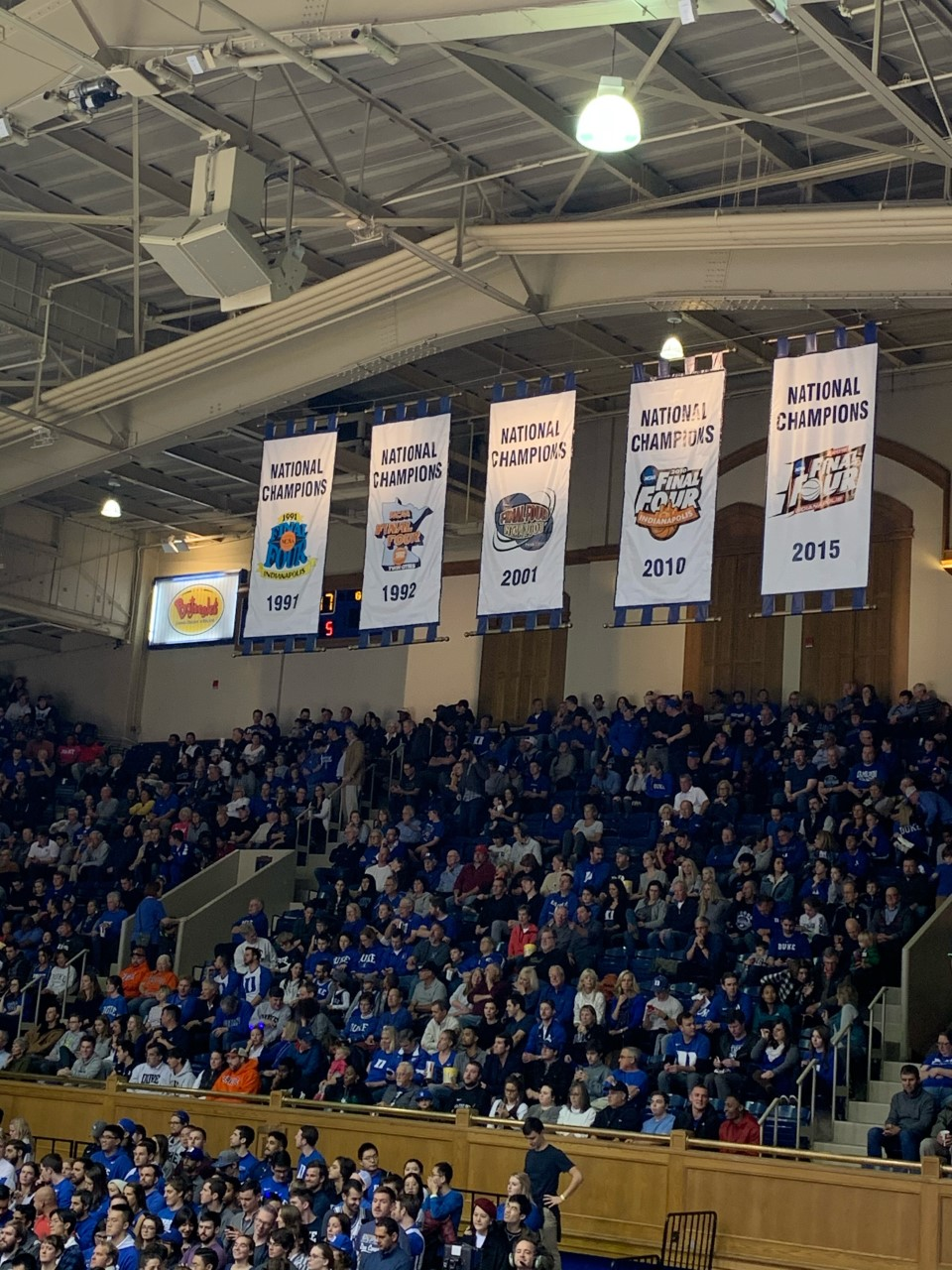 In addition to the retired jerseys, 5 banners hang on the opposite end of the gymnasium symbolizing the 5 National Championships won by each Duke program.