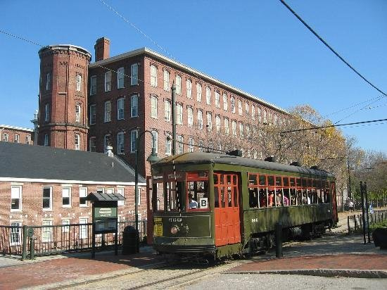 An exterior picture with a trolley tour passing by