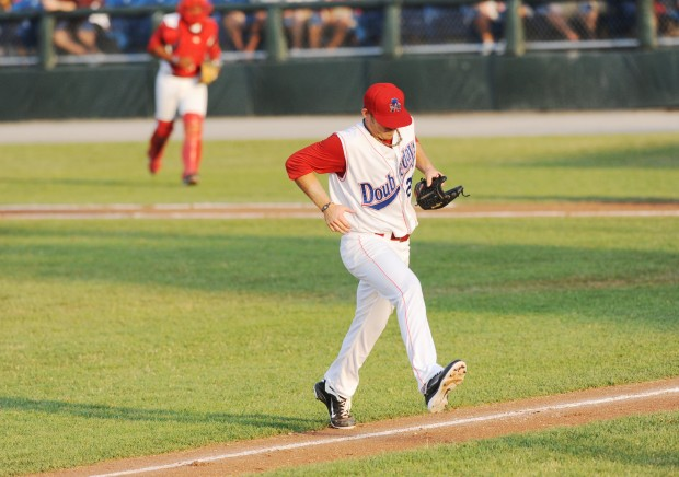 Nick Lee of the Auburn Doubledays steps over the foul line before and after every inning he goes to the mound to pitch.