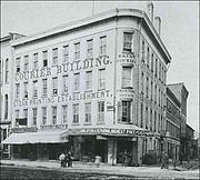 Historic photo of the Courier Building when it housed the Syracuse Daily Courier