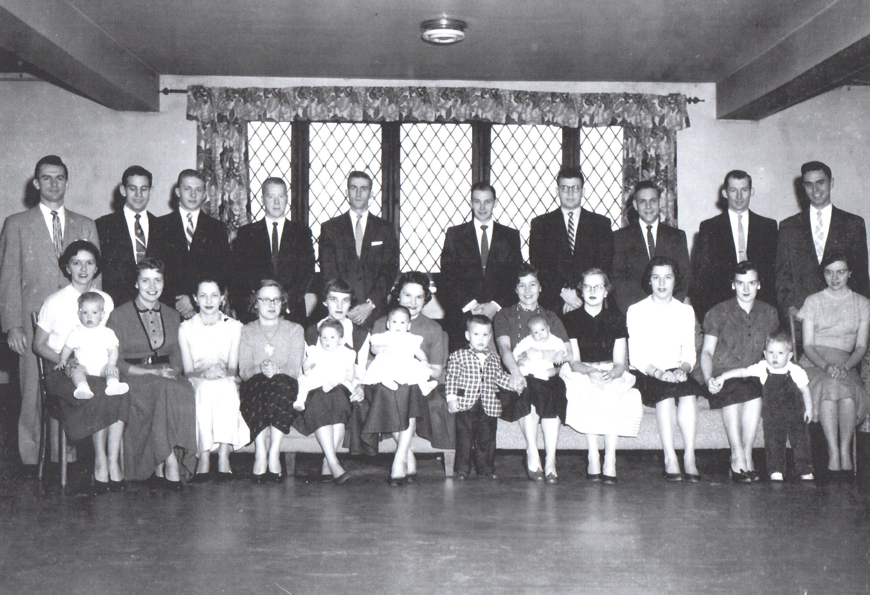 Another image of married students who lived on campus with their children. This group of veterans, spouses and children held monthly get togethers. Some of these get togethers include cookout, and social dances.