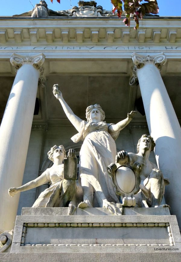 """""""The Light of the World"""" was carved by Hungarian native Albert Molnar, Sr. The central figure holds the torch of enlightenment and is framed by figures personifying the law and power."""