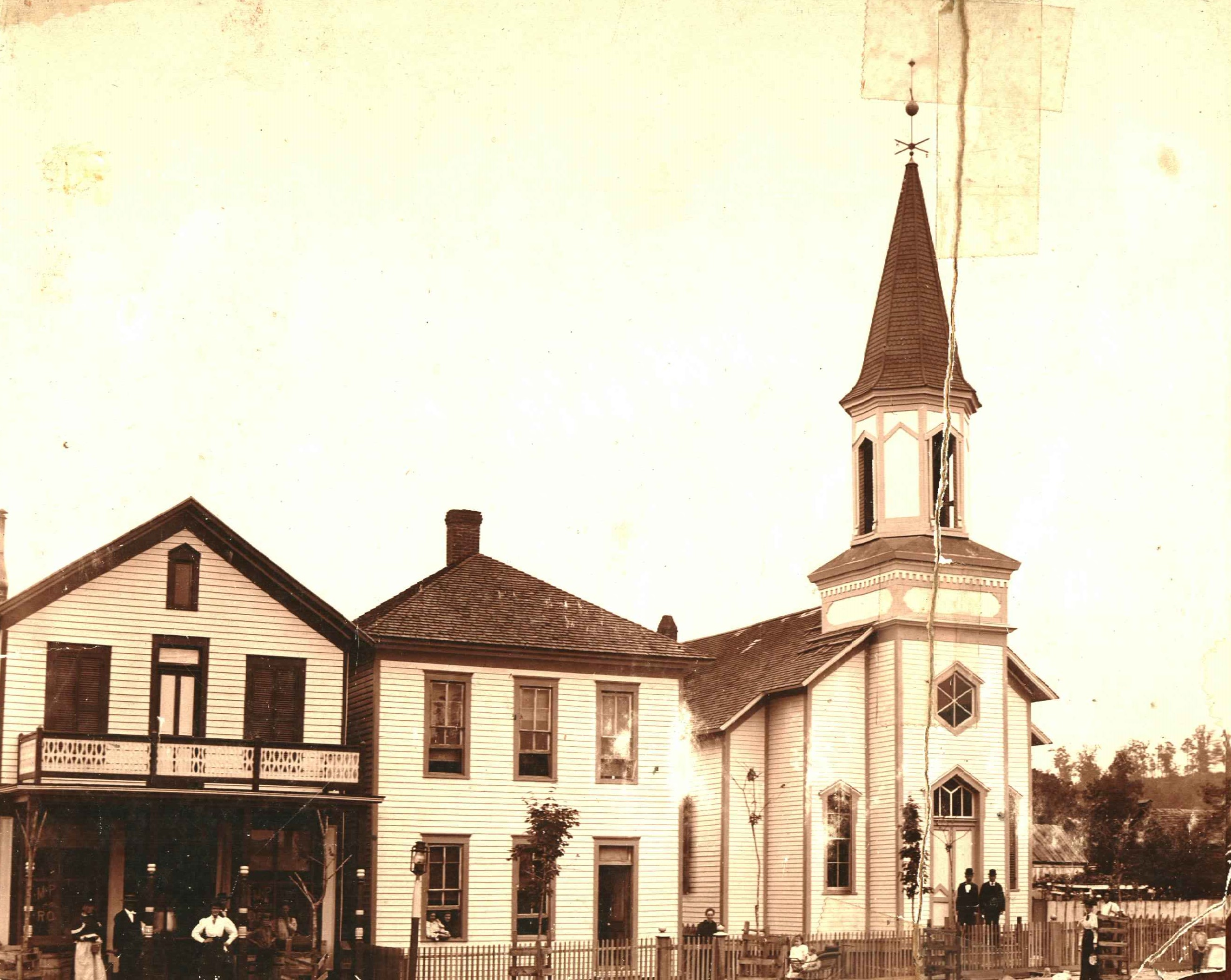 The sanctuary building sometime around the 1890s. The house to its immediate left is likely the parsonage, which was demolished in 1965.