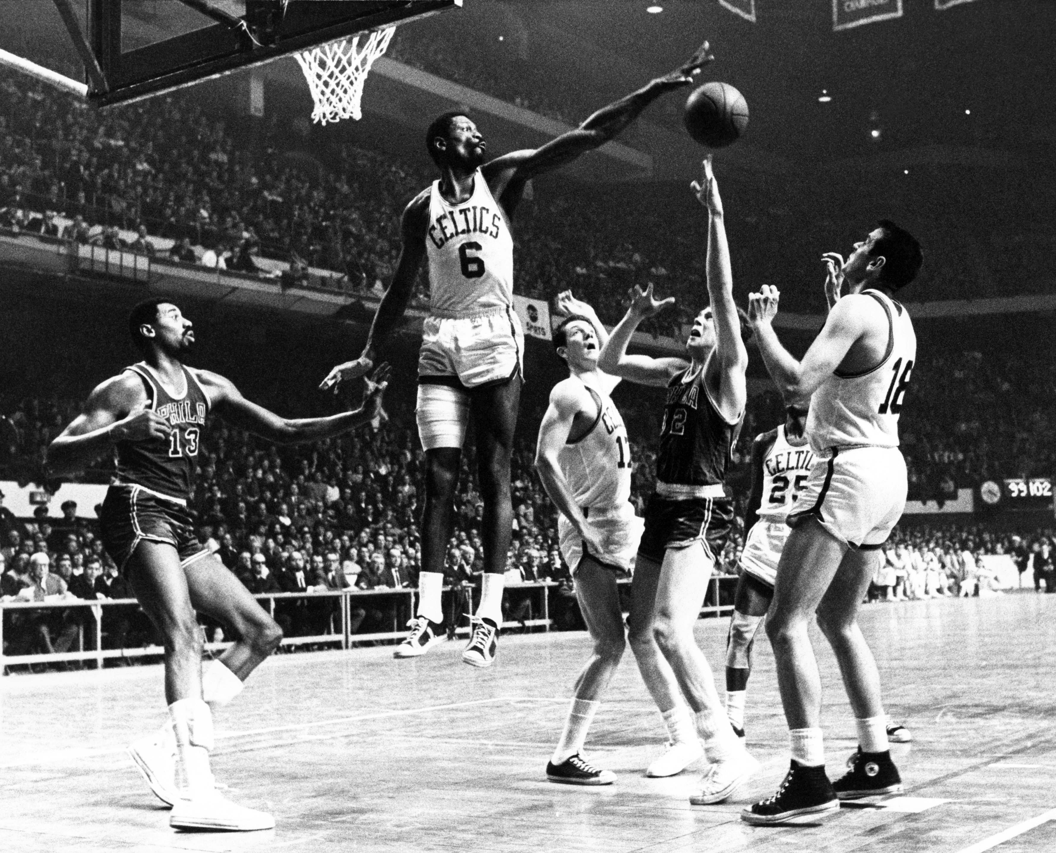 Bill Russell blocking a defenders shot in Boston Garden, very symbolical of how his career went.