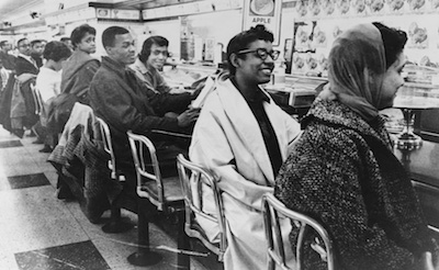 Sit in protesters sitting at the lunch counter in defiance of the store's policy of racial discrimination.
