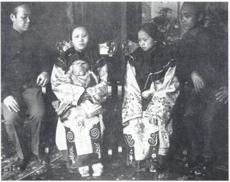 Photography businesses in Old Chinatown would take family portraits like this one for residents to send back to their relatives in China