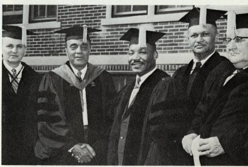 Charles H. Wesley and MLK JR. shake hands in 1958 after President Wesley presented King with an honorary doctorate.