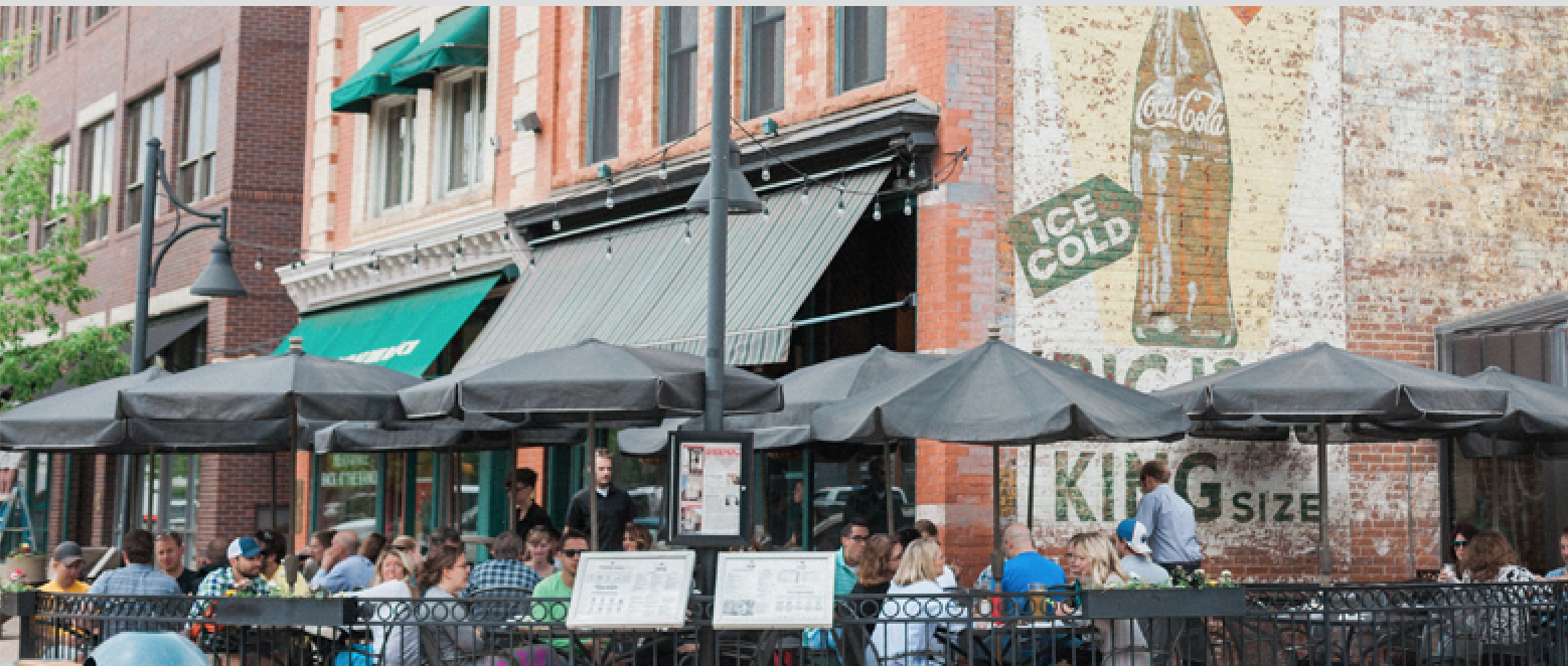 Patio of the Pubside, including the untouched Ghost signs of historic Old Town Square. (Courtesy of Coopersmithspub.com)