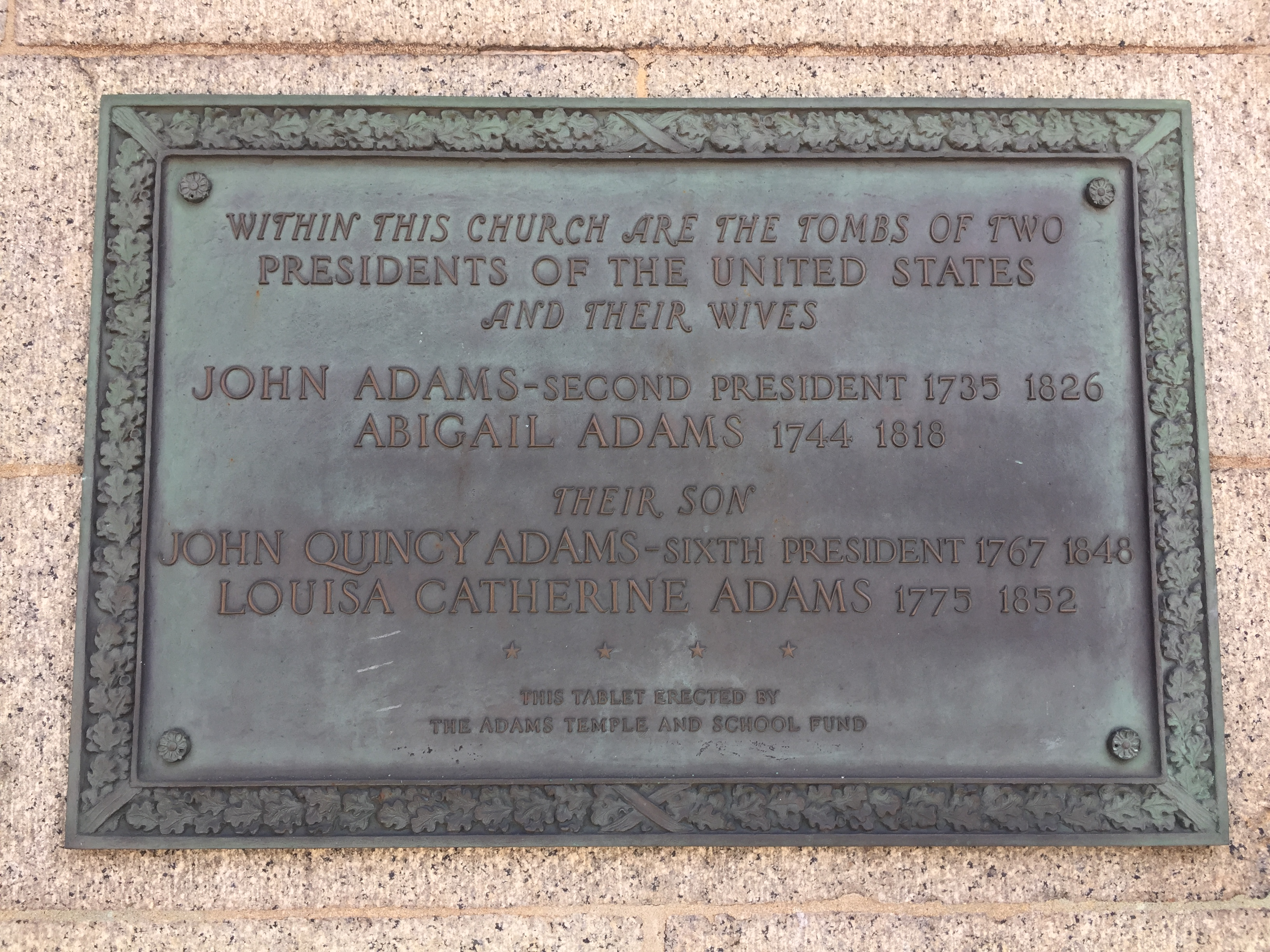 This plaque denoting the location of the Adams Crypt is affixed to the front of the church.