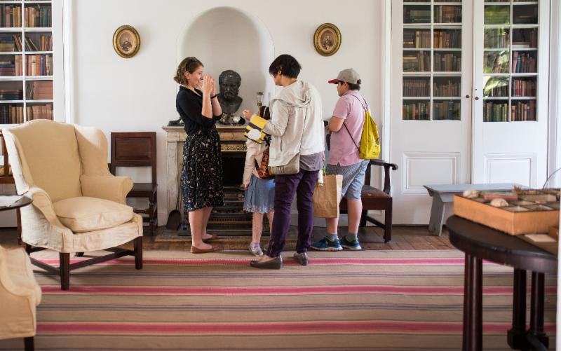 Visitors enjoy a house tour