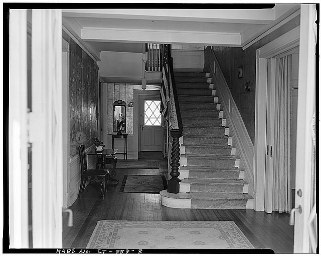 The central hall and staircase taken by the same Historic American Buildings Survey.