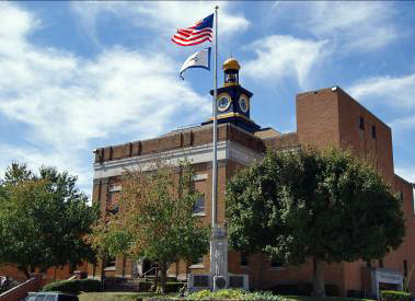 The fifth and current Wayne County Courthouse was built in 1923; newer additions were added in later years.