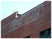 Formerly a Ford dealership, you can view the advertisement painted on the building that was removed during preservation.