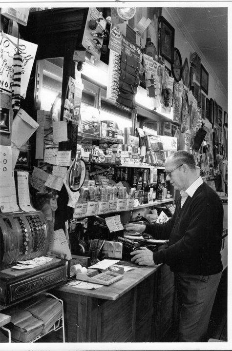 Former owner Floyd Bonafacio checking prices at his register when the store was in operation.