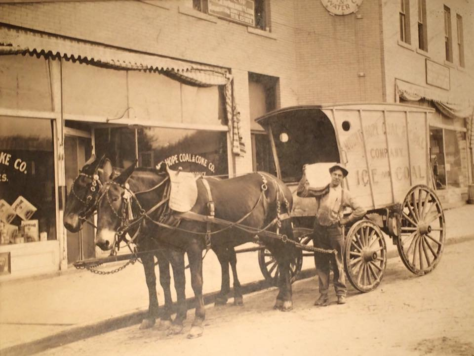 Prior to opening the Cobbler Shop and Confectionery in 1920 the buildings were used by the Mount Hope Coal and Coke Company.  Viewed in the front of the building is an ice delivery service.