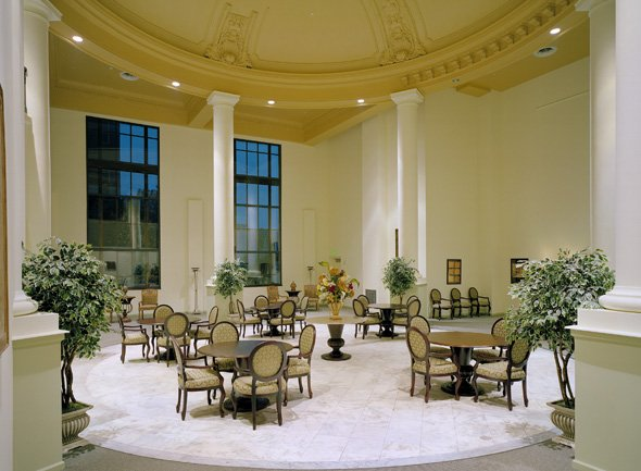 The former bank's main lobby now provides dining space for the building's residents.  Notice the original 32-foot dome above the dining tables.