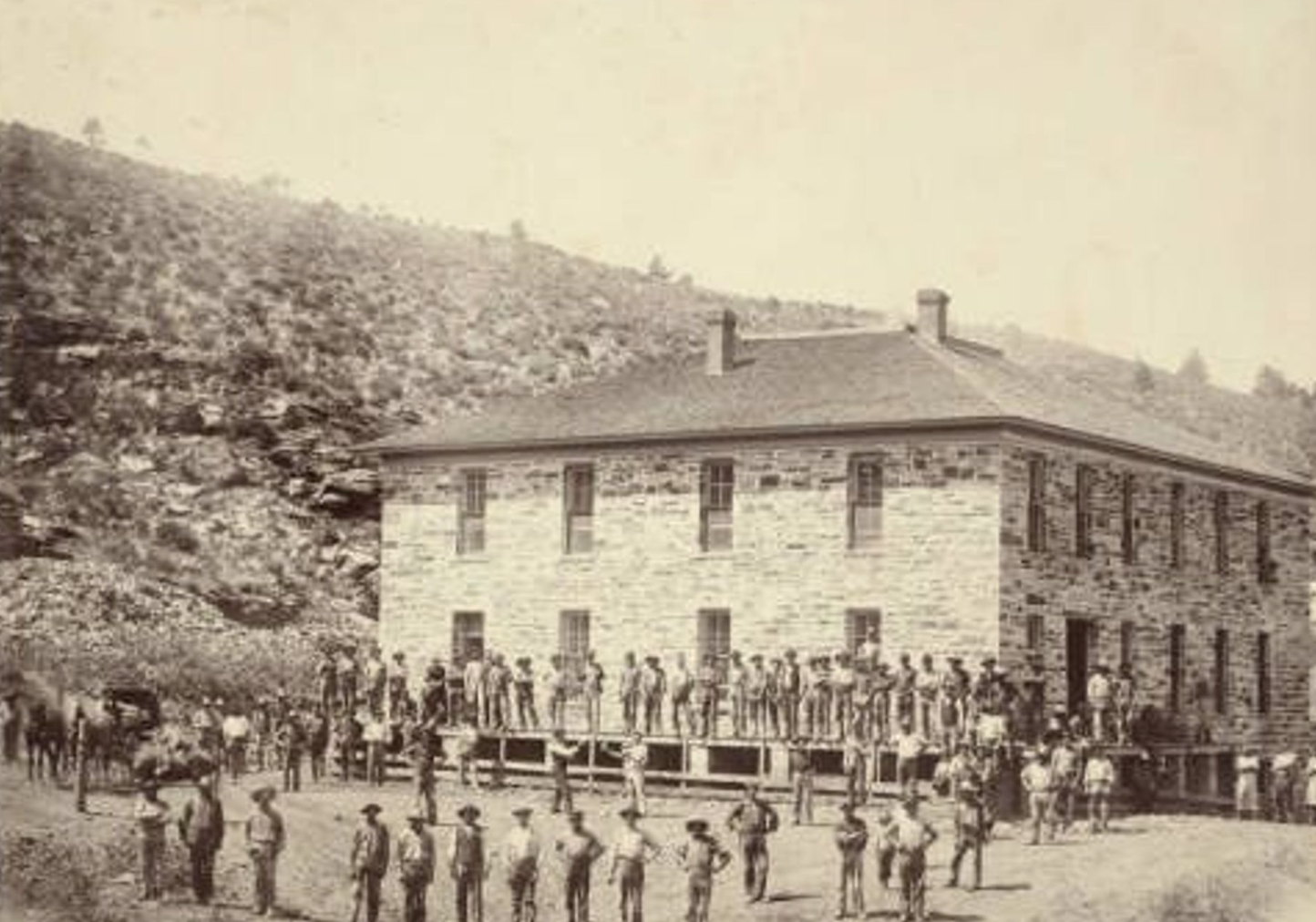 Quarriers near a stone lodging house, 1893. (Courtesy of Denver Public Library)