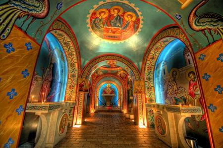 Inside the shrine. Note the Byzantine style frescoes highlighted with 22 Karat gold and art depicting many apostles and saints of the Christian church. Credit: Florida Department of the State