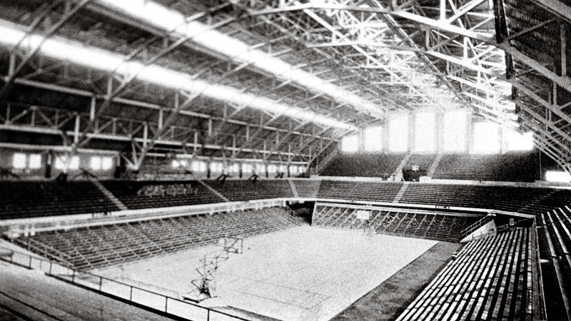 The floor with its original east/west configuration with the setting sun shining onto the court.  The layout was altered in 1933.
