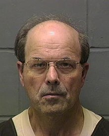 This is Dennis Rader's mugshot at the El Dorado Correctional Facility in Kansas. He is currently serving ten life sentences, one for each life he took.