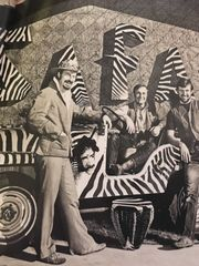 Primary source: Owner of the Safari Club Bob Swerer poses with his employees in the decor and costumes that themed the Safari Club.