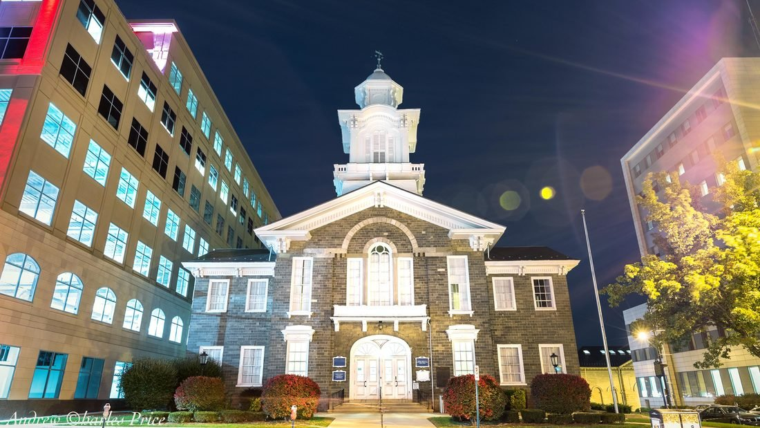 The Old Courthouse at night, surrounded by the modern buildings of Allentown.