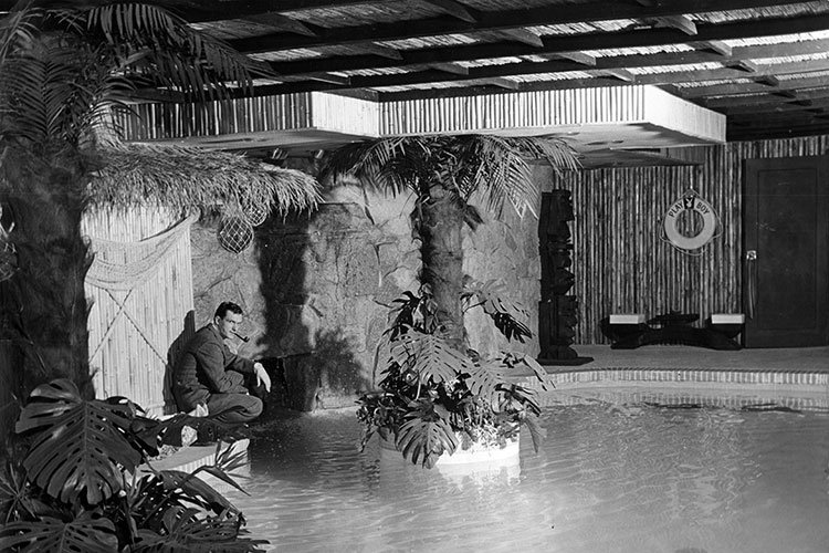 Hugh Hefner and the pool once located in the house's basement