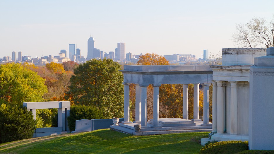 This photo shows the Indianapolis skyline behind the James Whitcomb Riley Monument.