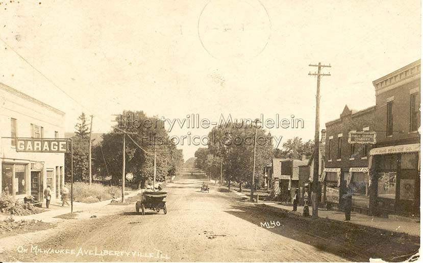 Looking north on Milwaukee Avenue, about 1912-1914, Libertyville Gargage on the left