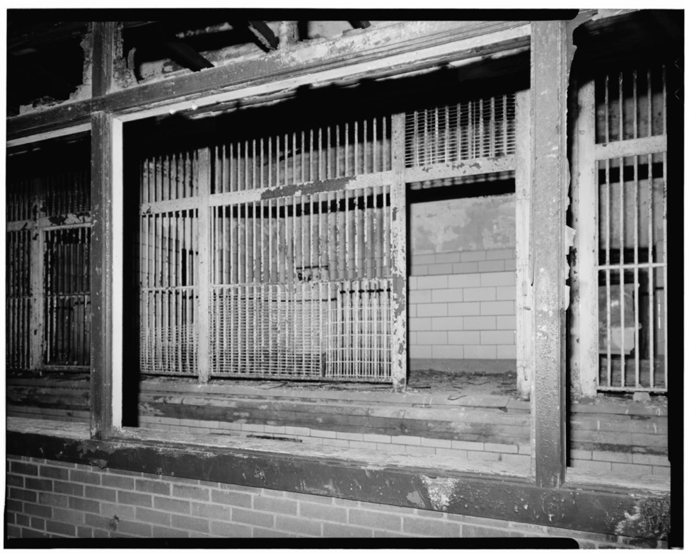 This black and white photo taken in 1978 shows the typical structure of an animal cage during this time at the Franklin Park Zoo. (Historic American Buildings Survey, By: Jack Maley, Photographer May 31, 1978 TYPICAL FELINE CAGE - Franklin Park Zoo)