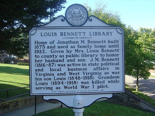 A historical marker stands in front of the house to commemorate the library. Image obtained from the Historical Marker Database.