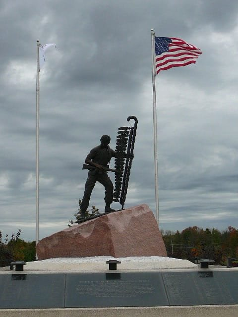 View from the front of the monument, showing the soldier with an M16 rifle and planting an eagle feather staff