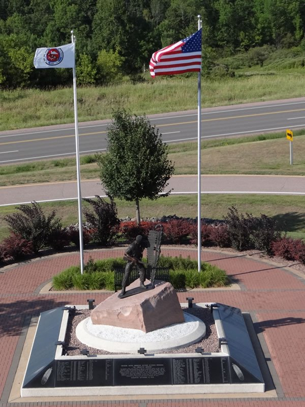 Aerial photo of the entire monument also showing the flags of the United States and a Native American tribe