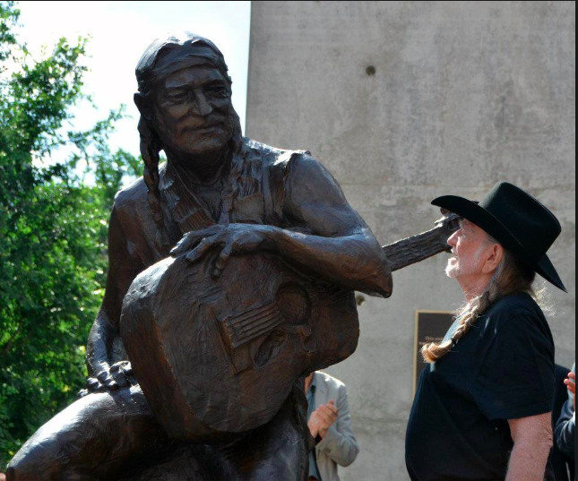 Willie Nelson admiring the Statue the day of the dedication.