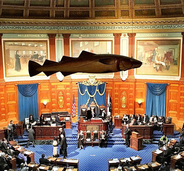 The Sacred Cod hanging in its current day location in the Chamber of the House of Representatives in the Massachusetts State House.