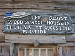Sign posted on entrance of schoolhouse