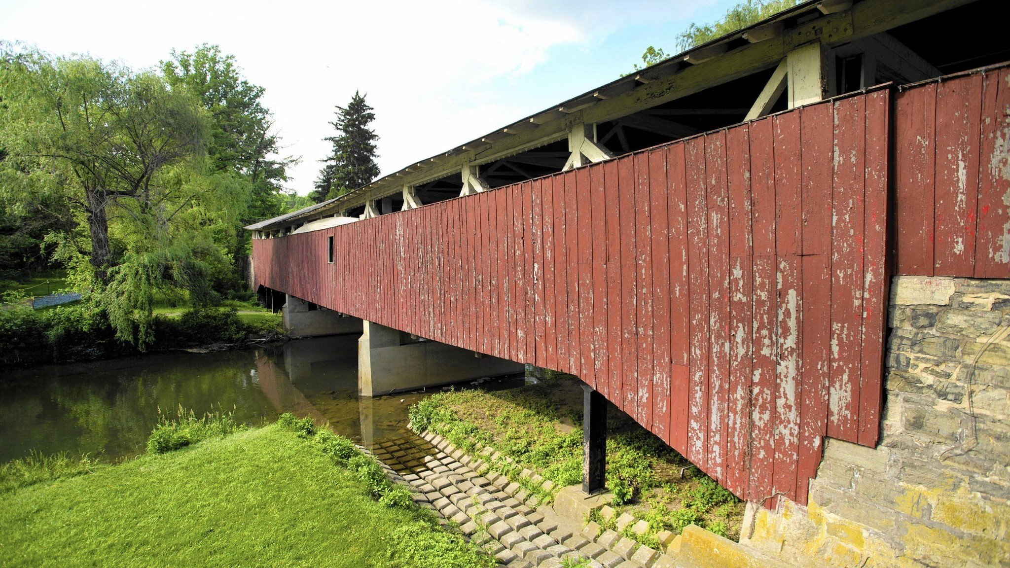 The covered bridge needs more than just the superficial renovations evident in this photo.