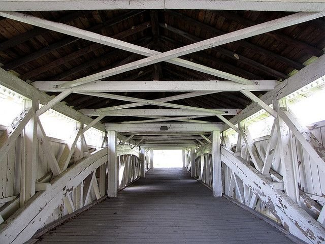 The two arch trusses can be seen in this interior photo of the bridge.