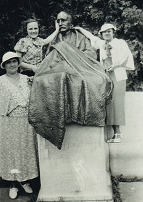 Family gathered around Dr. E.L. Trudeau Statue (undated)