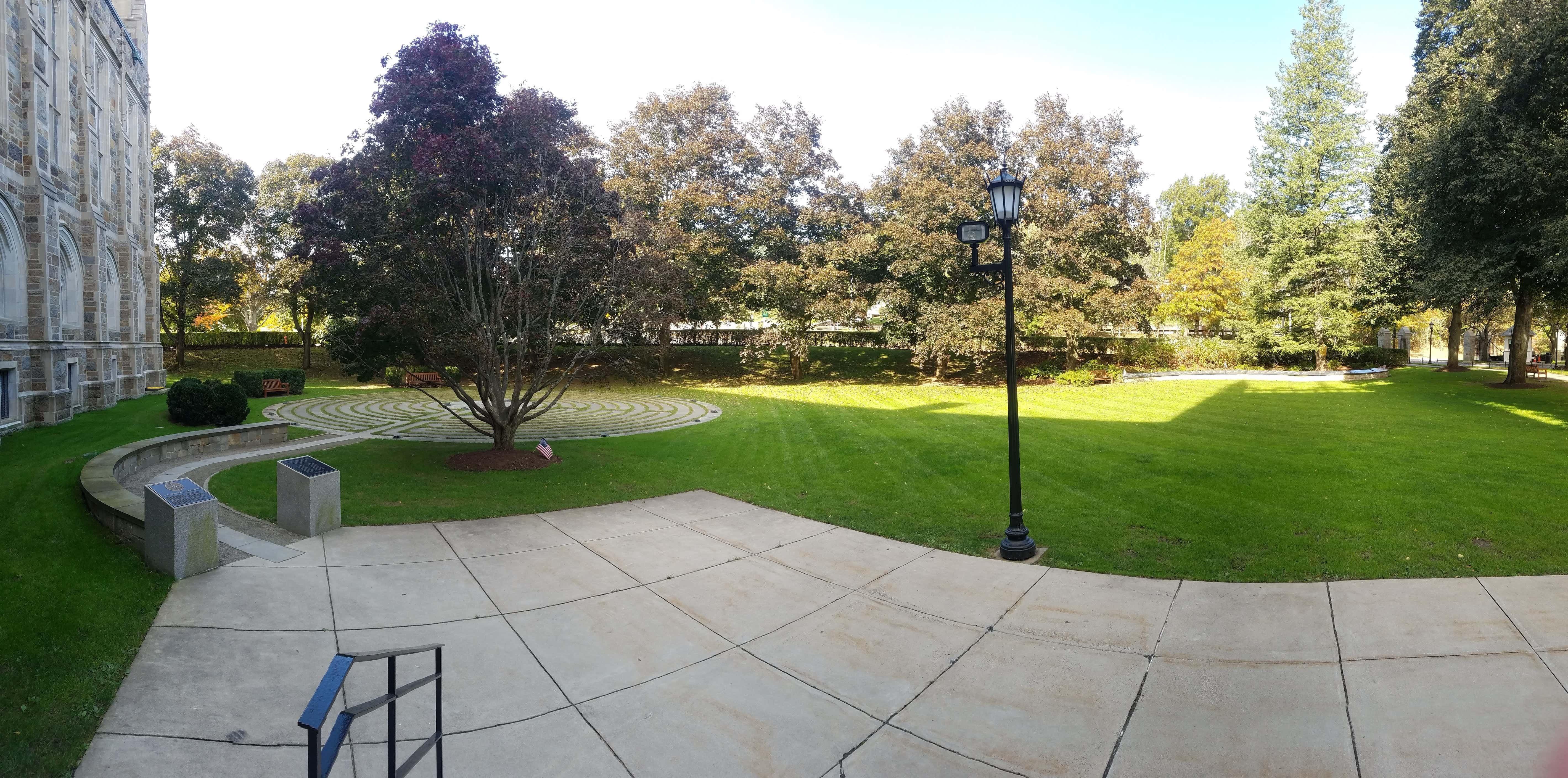 A panorama of the 9/11 Memorial Labyrinth and Veterans Memorial