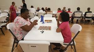 members of the community enjoy an afternoon in one of the recreation rooms inside the community center